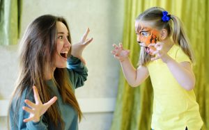 Entertainer and a face painted girl