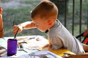 Kid painting paper animals