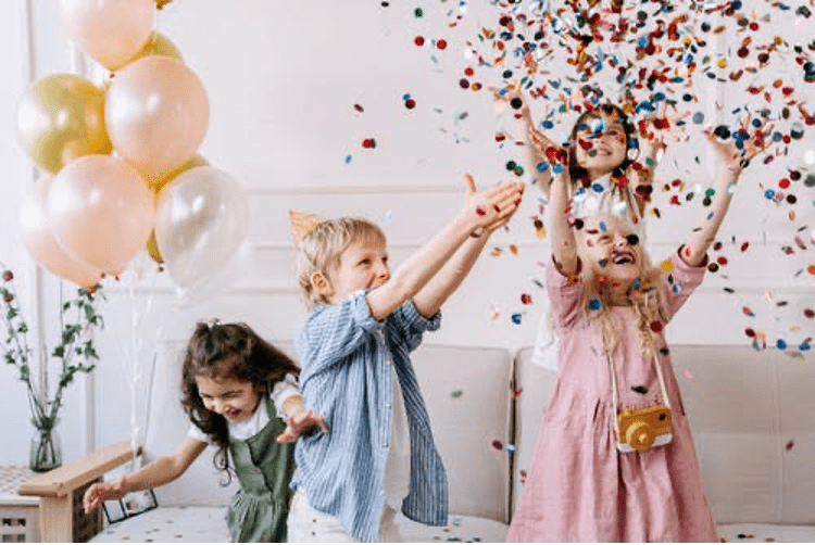 Kid's throwing confetti